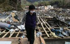 Tamiko Abe returns to Ogatsu, in Japan, to search for his family after the March 11 earthquake and tsunami. Picture: Alex Eliseev/EWN.