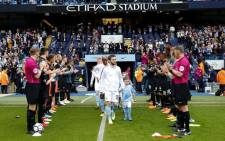 Champions Manchester City receive a guard of honour from Swansea players ahead of their English Premier League. Picture: @ManCity/Twitter