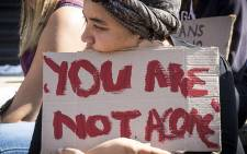 A UCT student holds up a poster during a protest against rape and sexual abuse on campus on 11 May 2016. Picture: Thomas Holder/EWN.