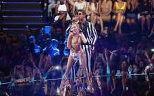 FILE: Miley Cyrus and Robin Thicke perform onstage during the 2013 MTV Video Music Awards on 25 August 2013 in New York City. Picture: AFP.