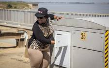 FILE: Water & Sanitation Minister Nomvula Mokonyane presses a button to open two sluice gates at the Vaal damn on 26 February 2017. Picture: Reinart Toerien/EWN