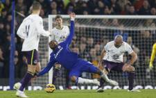 FILE: Chelsea's Ivorian striker Didier Drogba (2nd L) reacts as he is tackled during the English Premier League football match between Chelsea and Everton at Stamford Bridge in London on February 11, 2015. Picture: AFP