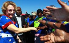 Democratic Alliance (DA) leader Helen Zillle is greeted by supporters at Phoenix township,south of Durban during Freedom Day Celebrations. Picture: Sapa.
