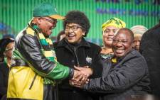 FILE: Winnie Madikizela-Mandela clasps the hands of President Jacob Zuma and Deputy President Cyril Ramaphosa at the ANC national policy conference at Nasrec on 30 June 2017. Picture: Thomas Holder/EWN