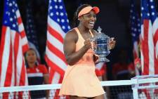 Sloane Stephens of the US poses with the championship trophy after defeating Madison Keys of the US in the Women's Singles final match on Day Thirteen during the 2017 US Open on 9 September, 2017 in the Queens borough of New York City. Picture: AFP.