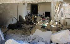 A picture taken on April 4, 2017 shows destruction at a hospital in Khan Sheikhun, a rebel-held town in the northwestern Syrian Idlib province, following a suspected toxic gas attack. A suspected chemical attack killed dozens of civilians including several children in rebel-held northwestern Syria, a monitor said, with the opposition accusing the government and demanding a UN investigation. Picture: AFP