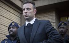 Convicted murderer Oscar Pistorius leaves the High Court in Pretoria after the conclusion of sentencing arguments in his murder trial. Picture: Reinart Toerien/EWN.