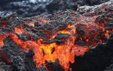 Lava flows at a lava fissure in the aftermath of eruptions from the Kilauea volcano on Hawaii's Big Island, on 12 May, 2018 in Pahoa, Hawaii. Picture: AFP