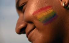A member of the Lesbian, Gay, Bisexual, Transgender, Transvestite, Transgender and Intersex (LGBTTTI) communities participates in a march against homophobia on 21 May 2016 in San Salvador. Picture: AFP.