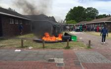 FILE: Student barricade access to two of UWCs residences with burning rubble during protests. Picture: Natalie Malgas/EWN.
