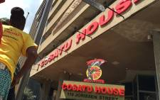 FILE: A small group of Cosatu members singing and dancing outside the Cosatu House in Johannesburg's CBD. Picture: EWN.