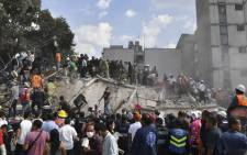 Rescue teams look for people trapped in the rubble after an earthquake in Mexico City on 19 September 2017. Picture: AFP.