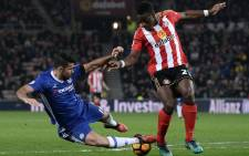 FILE: Chelsea's Brazilian-born Spanish striker Diego Costa (L) vies with Sunderland's French-born Ivorian defender Lamine Kone as the ball hits him from behind during the English Premier League football match between Sunderland and Chelsea. Picture: AFP.
