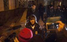 FILE: This file photo shows Minneapolis Police Chief Janee Harteau addressing protesters behind a barricade outside the 4th Precinct police station 20 November 2015. Picture: AFP.