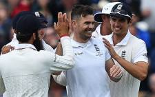 England's James Anderson (C) celebrates bowling out Australia's Peter Nevill on the first day of the third Ashes cricket test match between England and Australia at Edgbaston in Birmingham, central England, on 29 July, 2015. Picture: AFP.
