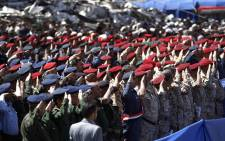 File: Army officers allied with the Houthis attend a rally to mark three years of war on the country, in the capital Sanaa on 26 March 2018. Picture: AFP