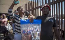 Angry consumers seen outside the Enterprise factory outlet in Germiston, where they donated their money back. Picture: Thomas Holder/EWN