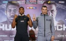 IBF world heavyweight champion Anthony Joshua (left) and challenger Wladimir Klitschko. Picture: AFP
