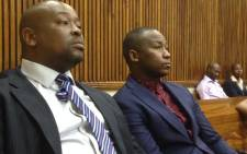 South African musician Khuli Chana (right) and his manager Refiloe Ramogase inside the Randburg Magistrates Court on 10 September 2014. Picture: Reinart Toerien/EWN.