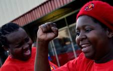 FILE: Striking mine workers who support the National Union of Mineworkers (NUM) take part in a protest in Carletonville on 3 September, 2013. Picture: AFP. ""
