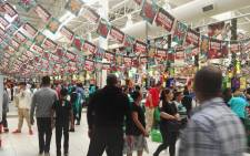 Checkers at N1 City is packed. Shoppers are standing in very long queues and already out of trolleys. Picture: Rafiq Wagiet/EWN.