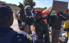 Zimbabwean, Zambian, DRC and Swaziland citizens are protesting outside the SADC summit against their heads of state. Picture: Hitekani Magwedze/EWN.
