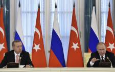 """Russian President Vladimir Putin (right) and his Turkish counterpart Recep Tayyip Erdogan answer journalists' questions during a press conference in Konstantinovsky Palace outside Saint Petersburg on 9 August 2016. Picture: AFP."""""""