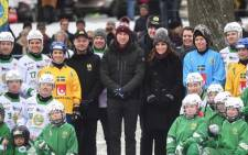 Britain's Prince William and his wife Kate pose together with youth from the Hammarby bandy sports club in Stockholm. Picture: @KensingtonRoyal/Twitter.