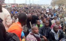 Lonmin miners make their way through Marikana, as they march, demanding better salaries. Picture: Taurai Maduna/EWN.