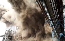 Smoke billows from a coal-fired power plant after a boiler unit exploded in the town of Unchahar in the northern Indian state of Uttar Pradesh on 1 November 2017. Picture: AFP