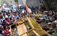 Indian Hindu right-wing activists lift the Police barricades outside Jawaharlal Nehru University (JNU) as they protest against alleged anti-national slogans by a group of JNU students, in New Delhi, India, 16 February 2016. Picture: EPA/RAJAT GUPTA.