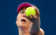 Maria Sharapova serves on the way to defeating Kaia Kanepi at the Brisbane International tennis tournament in Brisbane on January 2, 2014. Source: AFP