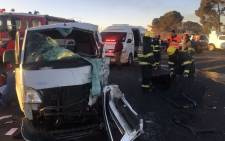EMS personnel are seen at the site of the accident that left two people dead on Malibongwe Drive. Picture: EWN Traffic.