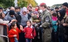 FILE: Migrants and refugees cross the Slovenian-Austrian border in Sentilj onto Spielfeld in October 2015. Picture: AFP.