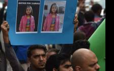 Pakistani human rights activists carry placards and banners during a protest against the rape and murder of a child in Karachi on 11 January 2018. Picture: AFP.