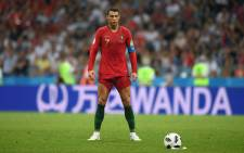 Cristiano Ronaldo lit up the World Cup in his own inimitable style, curling in a late free kick to complete a remarkable hat-trick in a group match between Portugal and Spain. Picture: @FIFAWorldCup/Twitter.