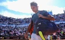 FILE: A dejected Roger Federer walks off court after being knocked out of the Italian Open by Jeremy Chardy. Picture: Facebook.com