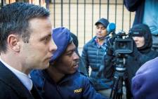 Oscar Pistorius makes his way into the Pretoria High Court for sentencing. Picture: Thomas Holder/EWN