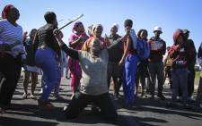 FILE: A group of disgruntled Vrygrond residents have vowed to continue protesting if authorities keep evicting them from a piece of land next to the community. Picture: Cindy Archillies/EWN