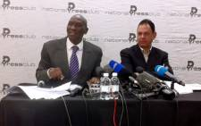 Former top cop Bheki Cele speaks at the National Press Club after being sacked. With him is press club chairman Yusuf Abramjee Picture: Taurai Maduna/EWN