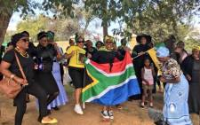 Mourners and supporters singing outside Fourways Memorial Park where Winnie Madikizela-Mandela will be laid to rest. Picture: Katleho Sekhotho/EWN.