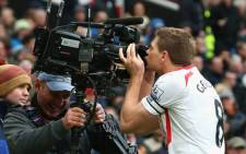 Liverpool captain Steven Gerrard kisses a camera after scoring against Manchester United at Old Trafford on 16 March 2014. Liverpool won 3-0. Picture: Facebook