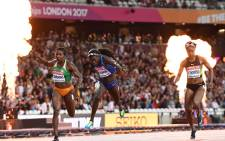 US athlete Tori Bowie (C) crosses the finish line next to Ivory Coast's Murielle Ahoure (L) and Jamaica's Elaine Thompson to win the final of the women's 100m athletics event at the 2017 IAAF World Championships at the London Stadium in London on August 6, 2017.  (Picture: AFP