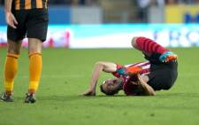 Southampton's Serbian midfielder Dusan Tadic falls to the ground during the English Premier League football match between Hull City and Southampton at the KC Stadium in Kingston upon Hull, East England, on 1 November, 2014. Picture: AFP.
