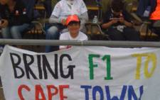 The Sadick De Doncker family was rooting for the Cape Town Grand Prix at the Silverstone Grand Prix in the UK on Sunday 10 July 2011. Picture: Shafick Hassan/iWitness