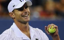 US Andy Roddick reacts after winning against Australia's Bernard Tomic during their 2012 US Open men's singles match on 31 August, 2012. Picture: AFP.