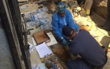 Police have discovered over 60 bombs and AK-47 guns, amongst others at the back of a shop in Randburg. Picture: Pelane Pjakgadi/EWN