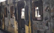 Eight train carriages have been destroyed at Cape Town Train Station. Picture: Cindy Archillies/EWN
