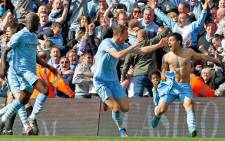 Sergio Aguero celebrates with his Manchester City teammates after scoring the goal that secured Manchester City the 2011-12 English Premier League title. Picture: Facebook.