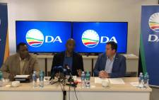 DA Leader Mmusi Maimane (C) briefing the media on the performance of President Cyril Ramaphosa in his first 100 days. Picture: Our_DA/twitter.